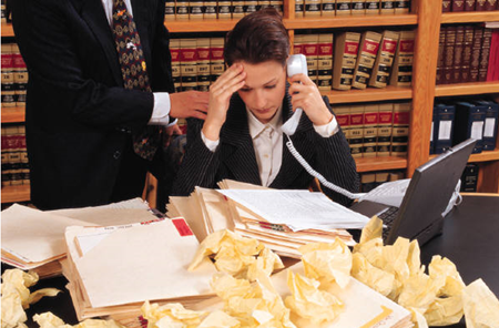 Woman overwhelmed with work