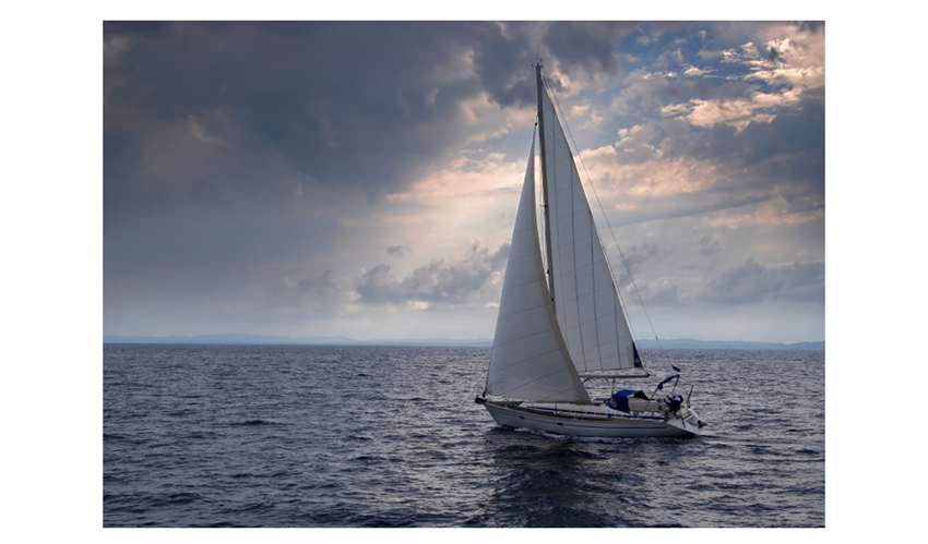 "Picture of sailing boat and quote, ""I can't change the direction of the wind but I can adjust my sails to always reach my destination"". - James Dean"
